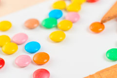 Close-up of colorful candies jelly beans. On white table Royalty Free Stock Image