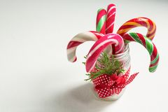 Close up of colorful candy canes in glass jar stock photos