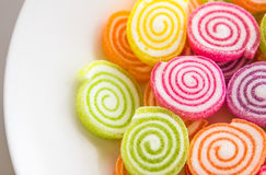 Close up of colorful candy on the plate Stock Photo