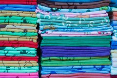 Close up of colorful clothes. Stack Royalty Free Stock Photos