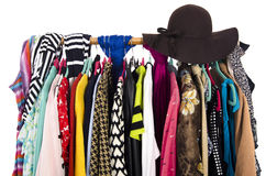 Close up on colorful clothes and hat on hangers in a store. Royalty Free Stock Image