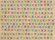 Close up of colorful cross stitch detail on designer cushion Royalty Free Stock Photo