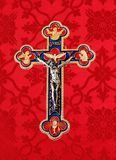 Red gold and blue crucifix isolated on red material stock images