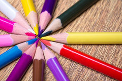 Close up of colorful drawing pencils on wooden table Stock Photos