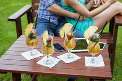 A close-up of colorful drinks tablet and smartphones on the tabl Stock Images