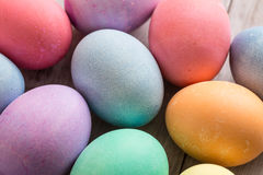 Close up of Colorful Easter Egge on Wood Background. Close up of colored Easter eggs on wood background Royalty Free Stock Photo