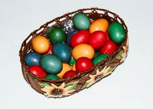 Close up of colorful Easter eggs in a basket. Happy Easter, Christian religious holiday. Close up of colorful Easter eggs in a basket. Happy Easter, Christian stock photo