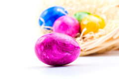Close up of colorful easter eggs in basket Royalty Free Stock Image