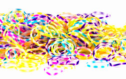 Close up of colorful elastic loom bands rainbow color full on wh Royalty Free Stock Photography