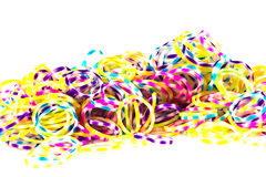 Close up of colorful elastic loom bands rainbow color full on wh Stock Photos
