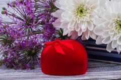 Close up colorful flowers and red gift box. Marriage proposal for beloved woman. Romantic love design. Symbol of love royalty free stock photo