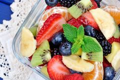 Colorful fresh fruit salad in a bowl stock image