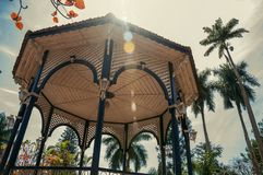 Close-up of colorful gazebo ceiling in the middle of garden full of trees, in sunny day at São Manuel. stock image