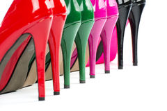 Close-up of colorful high heels shoes. Details of the heels of four pairs of colorful high heels shoes Stock Photography