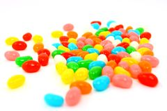 Close-up Of Colorful Jelly Beans On White. A close-up photo of assorted colorful jelly bean candies photographed on a white background stock photo