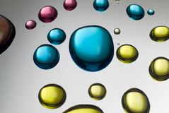 Close up of colorful liquid drops Stock Photography