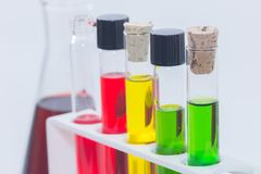 Colorful liquid in test tubes on rack. Close up of colorful liquid in test tubes on rack Stock Photography