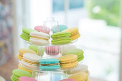 Close-up colorful macarons on pyramid-shaped plastic stand Stock Photos