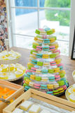 Close-up colorful macarons on pyramid-shaped plastic stand Royalty Free Stock Photo