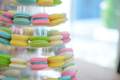 Close-up colorful macarons on pyramid-shaped plastic stand Stock Photography