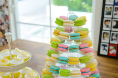 Close-up colorful macarons on pyramid-shaped plastic stand Royalty Free Stock Images