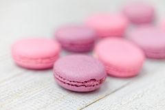 Close up of colorful macaroons on white wooden table Stock Photography