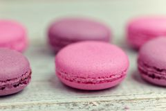 Close up of colorful macaroons on white wooden table Royalty Free Stock Images