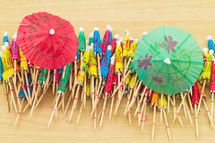 Close up colorful of many  cocktail umbrellas on white wooden ba Royalty Free Stock Photos