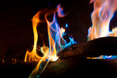Close Up Colorful Mineral Fire. A close view of colorful flames created by throwing minerals in a fire. Minerals include, copper, potassium, lithium, and cupric Royalty Free Stock Images