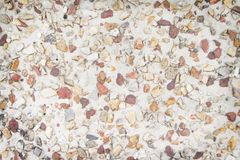 Colorful multicolored small gravel floor nature patterns texture for background , browm white and red. Close up Colorful multicolored small gravel floor nature royalty free stock photo