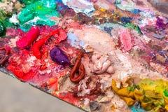 Close-up oil paints on the palette stock photos