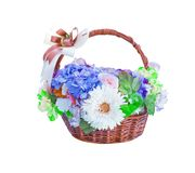 Colorful ornamental variety of flowers in the gift wood basket with hydrangea ,rose, chrysanthemum and bow ribbon natural patterns royalty free stock image