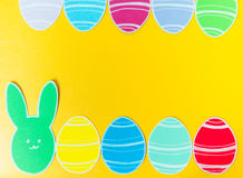 Close-up of colorful paper rabbit and paper eggs silhouette frames against canvas background Stock Photography