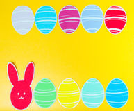 Close-up of colorful paper rabbit and paper eggs silhouette frames against canvas background.  Stock Photography