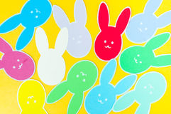 Close-up of colorful paper rabbits silhouette frames against golden background.  Royalty Free Stock Photos