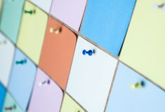 Close up of colorful paper stickers. NBlank sticky notes on office wall.nsticky note isolate on white backgroundn stock images