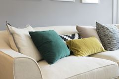 Colorful pillows on sofa in modern living room. Close up of colorful pillows on sofa in modern living room Royalty Free Stock Image