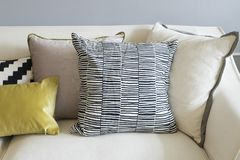 Colorful pillows on sofa in modern living room. Close up of colorful pillows on sofa in modern living room Stock Photos