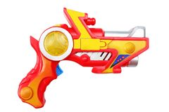 Colorful plastic pistol isolated on white background royalty free stock images