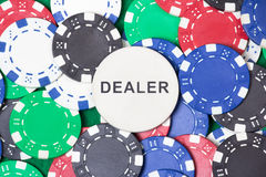 Close up of colorful poker chips and big dealer chip Stock Photography