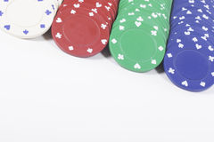 Close up on colorful poker chips over white Royalty Free Stock Photography