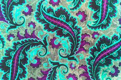 Lovely botanic paisley pattern. A close up of a colorful printed shabby chic  paisley pattern in mauve,blue and grey Royalty Free Stock Images