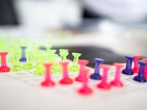 Colorful push pins marking for real estate resevation stock photo