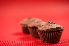Close-up of colorful red muffins with dark chocolate topping Stock Photography
