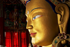 Close up colorful sculpture of Maitreya buddha Stock Photo