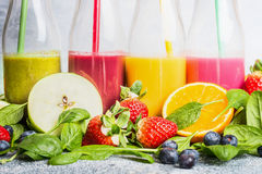 Close up of colorful smoothies with various ingredients. Stock Images