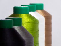 A close-up of colorful spools of thread, stock photo