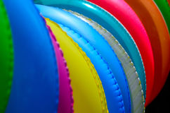 The close up of colorful swimming rings Royalty Free Stock Photos