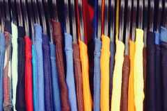 Close up Colorful T Shirts are hanging on rack stock photography