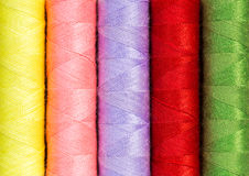 Close up colorful thread spools used in fabric and textile indus Stock Photography